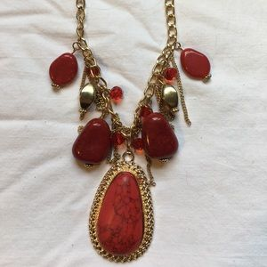 Red, ornate statement necklace.